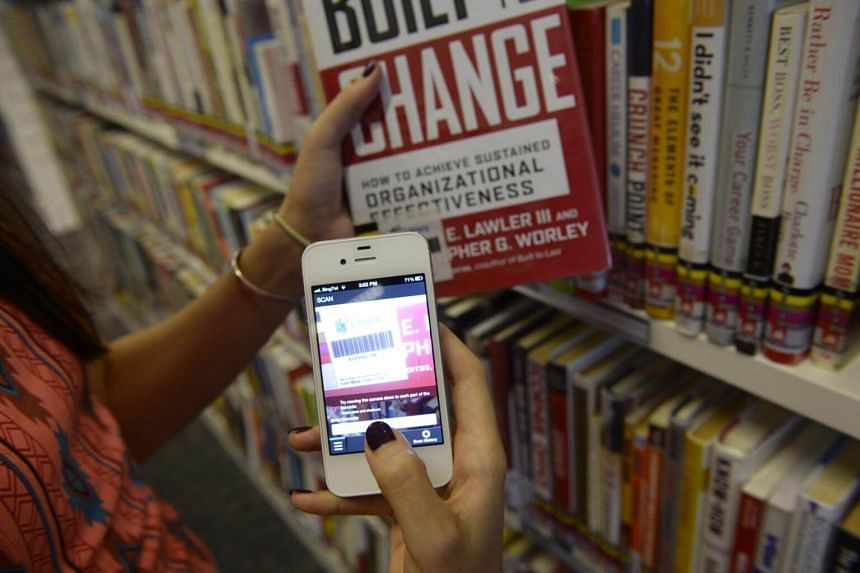A library user with a smartphone using the app launched by National Library Board.