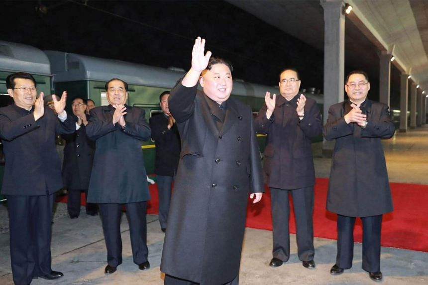 North Korean leader Kim Jong Un waving to well-wishers at an undisclosed location in North Korea before travelling to Russia by train.