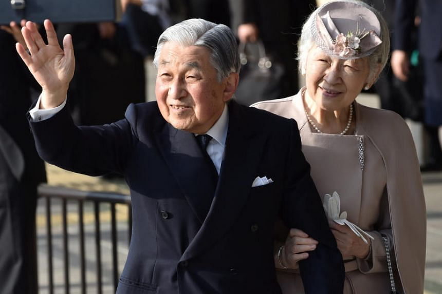 Japan's Emperor Akihito, accompanied by Empress Michiko, waves to well-wishers before leaving Ujiyamada Station in the central Japanese prefecture of Mie, on April 18, 2019.