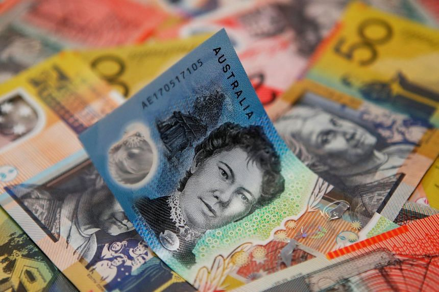 The Australian dollar tumbled to six-week lows on Wednesday and three-year bonds rallied to record highs after surprisingly weak inflation figures boosted calls for rate cuts.