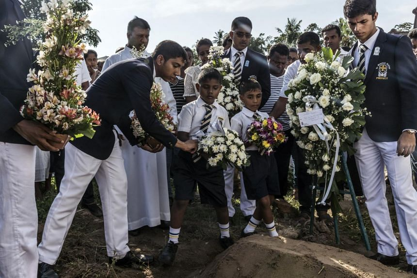 Flowers being laid at the burial site of a victim of the Easter Sunday bomb blasts at Sellakanda Catholic Cemetery in Negombo, Sri Lanka, on April 23, 2019.