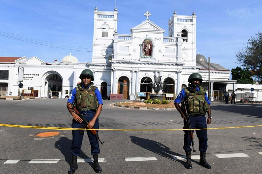 Security personnel stand guard in front of St Anthony's Shrine two days after it was attacked as part of a string of suicide bomb attacks on churches and hotels, in Colombo, on April 23, 2019.
