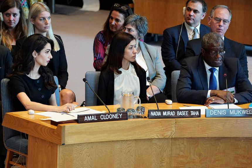 International human rights lawyer Amal Clooney and Nobel Peace Prize winner Nadia Murad listen to Congolese doctor Denis Mukwege speaking at the UN Security Council during a meeting about sexual violence in conflict in New York, on April 23, 2019.