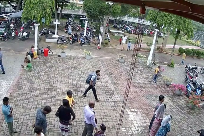 An image from CCTV footage shows a suspected suicide bomber with a backpack on a street in Negombo, about 40km from Colombo, on Easter Sunday. At least 321 people were killed in the suicide bombings that day.