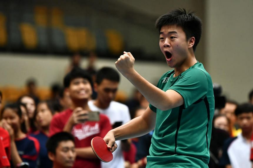 Raffles Institution's Lim Jun Kai celebrates after winning his game against Jaedon Foo from Hwa Chong Institution in the Schools National B Division Boys table tennis final at Our Tampines Hub on April 24, 2019.