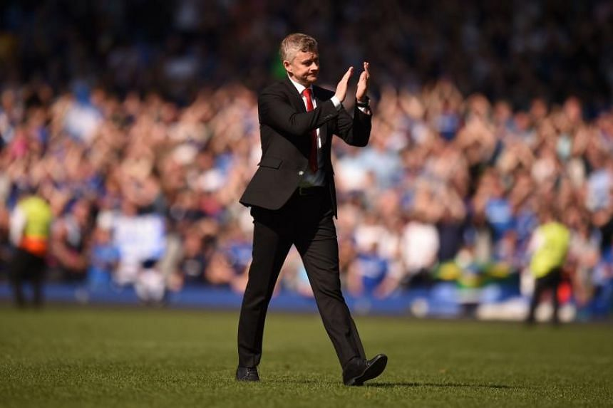 Manchester United's Norwegian manager Ole Gunnar Solskjaer applauds the fans after the final whistle in the English Premier League football match between Everton and Manchester United at Goodison Park in England on April 21, 2019.