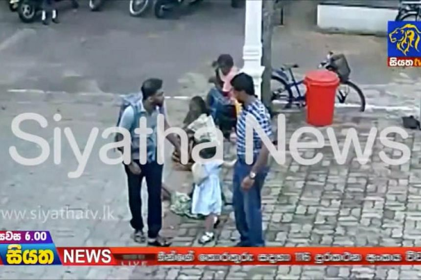Security camera footage shows a bearded man in a light blue shirt, navy trousers and sandals appear on a pathway and cross a courtyard outside  St Sebastian's Church in Negombo.