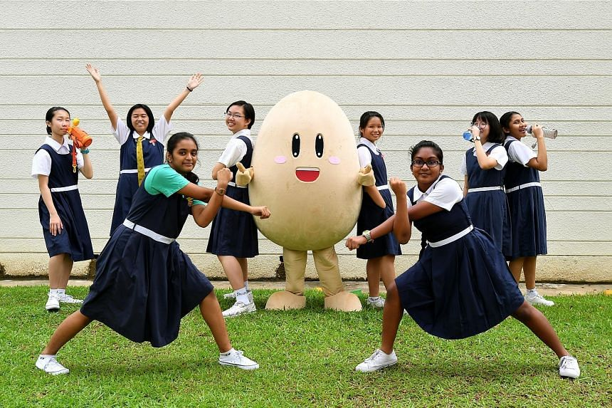 Health ambassadors from Paya Lebar Methodist Girls' School (Secondary) with their campaign mascot P.E.Z, which stands for passionate, energetic and zealous. The school held a pledge-taking event yesterday with students committing to reduce their suga