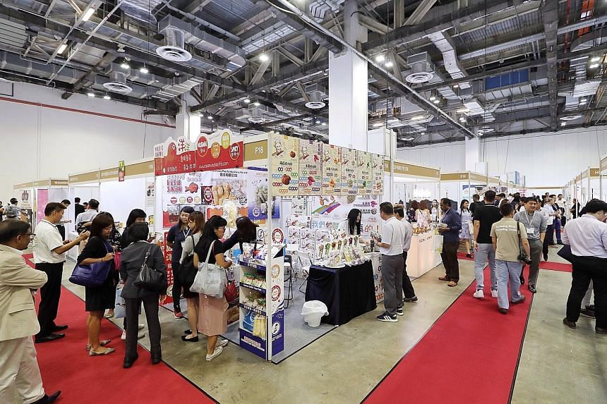 The inaugural Superfood Asia exhibition, which opened yesterday, is held at the Sands Expo and Convention Centre. The three-day event is open to trade visitors only and features over 80 exhibitors showcasing some 200 brands from across Asia. ST PHOTO
