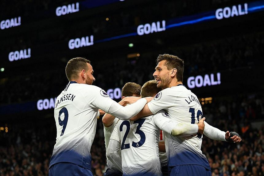 Christian Eriksen celebrating with Tottenham teammates, including Vincent Janssen and Fernando Llorente, after breaking the deadlock late in their home Premier League game against Brighton on Tuesday night. Spurs are third while the Seagulls stay thr