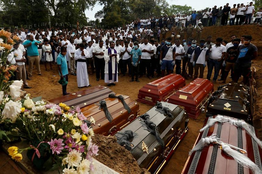 People participate in a mass funeral in Negombo, Sri Lanka, on April 24, 2019.