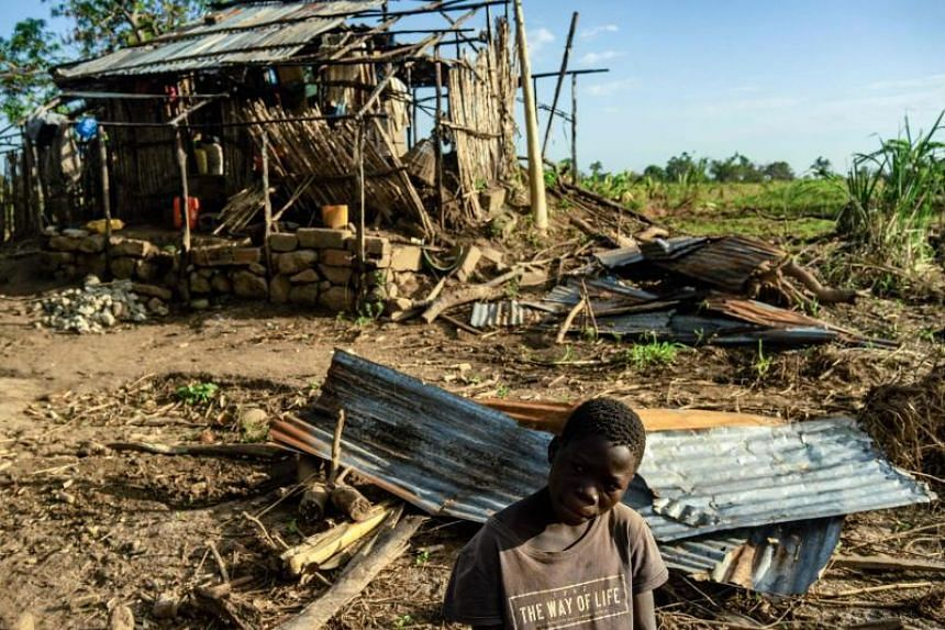 A boy sits in front of the wreckage of his house in Mananga-Batista village, Mozambique, which was destroyed when Cyclone Idai struck the country in March, killing more than 1,000 people.