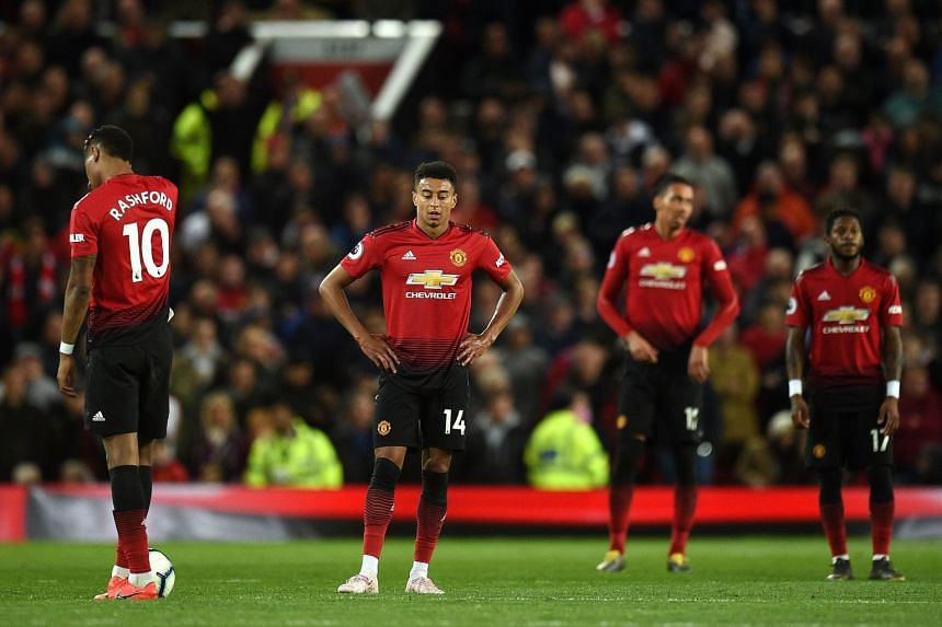 Rashford (from left), Jesse Lingard, Chris Smalling and Fred react after conceding a goal.