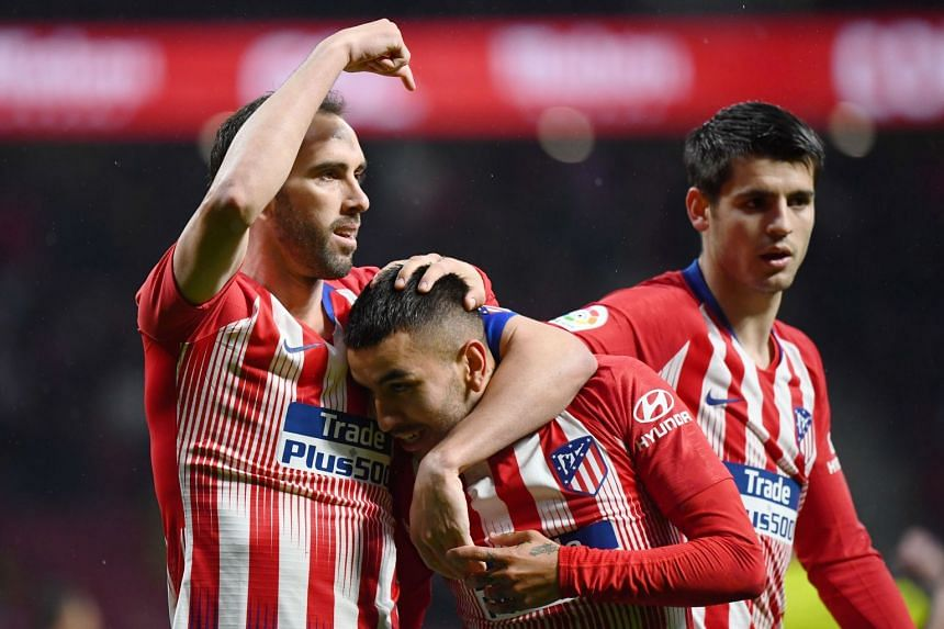 Atletico's Angel Correa (centre) is congratulated for his goal by Diego Godin (left).