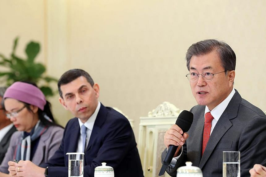 South Korean President Moon Jae-in speaking to a group of visiting editors from the Asia News Network, including The Straits Times editor Warren Fernandez (centre).