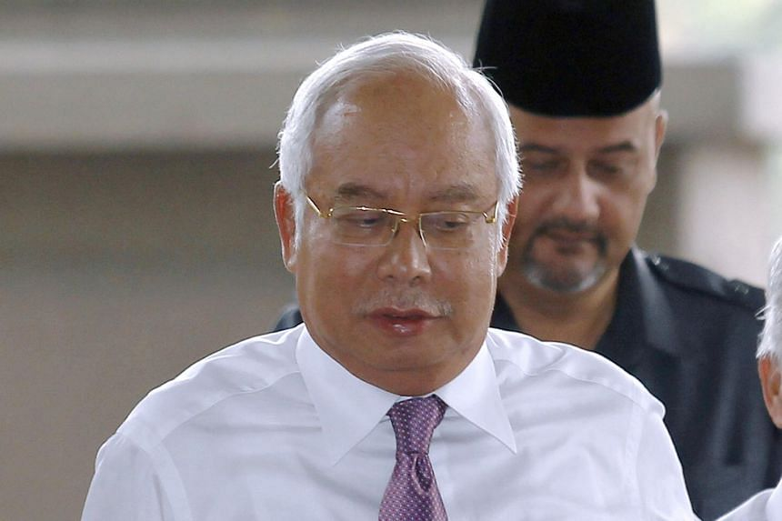 Malaysian former Prime Minister Najib Razak arrives at Kuala Lumpur High Court where he faces charges of money laundering linked to the 1Malaysia Development Berhad scandal, on April 23, 2019.