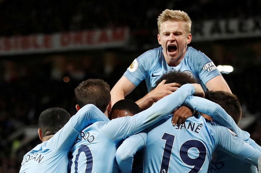 Manchester City's Leroy Sane celebrates scoring their second goal with Oleksandr Zinchenko and his team mates.