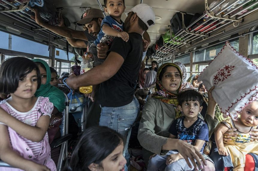 Muslims in Negombo, Sri Lanka, are relocated by bus to another town for their safety on April 24, 2019, three days after the Easter bombings.