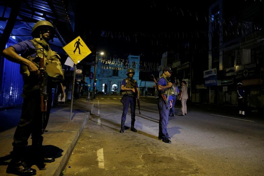 Security forces stand guard outside St Antony's Shrine, in Colombo, Sri Lanka, on April 24, 2019.