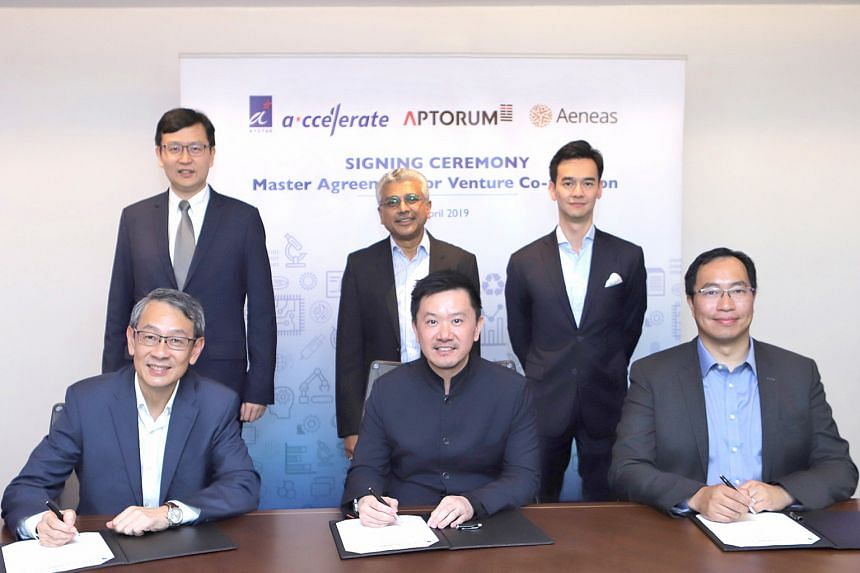 Representatives at the signing of the agreement to co-create local deep tech start-ups in the healthcare and life sciences sector: (seated from left) Mr Philip Lim, CEO of A*ccelerate Technologies, Mr Ian Huen, founder and CEO of Aptorum Group, and M