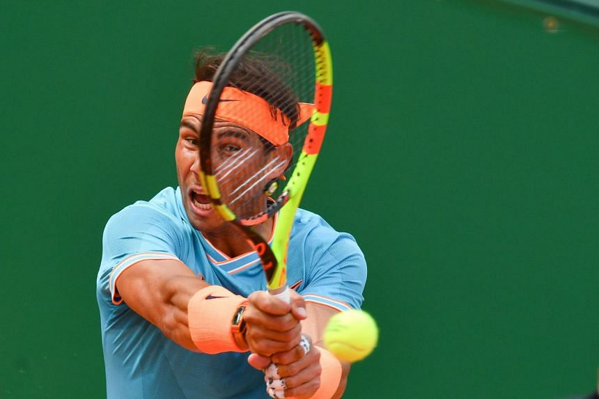 Nadal (above, in the Monte Carlo Masters) was made to work hard for his 6-7 (7/9), 6-4, 6-2 victory.