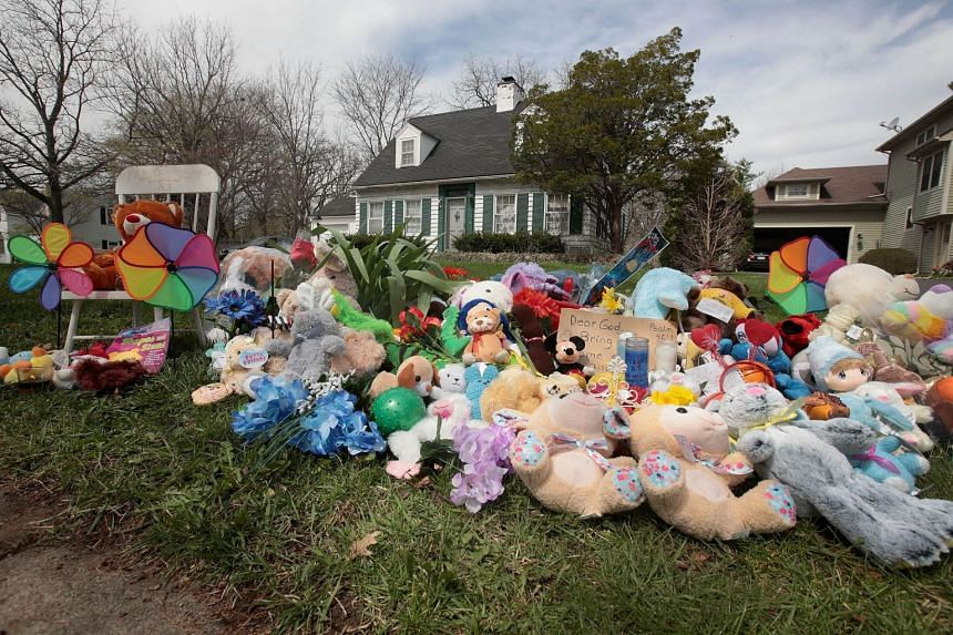 """A small memorial sits outside the home of Andrew """"AJ"""" Freund on April 24, 2019, in Crystal Lake, Illinois."""