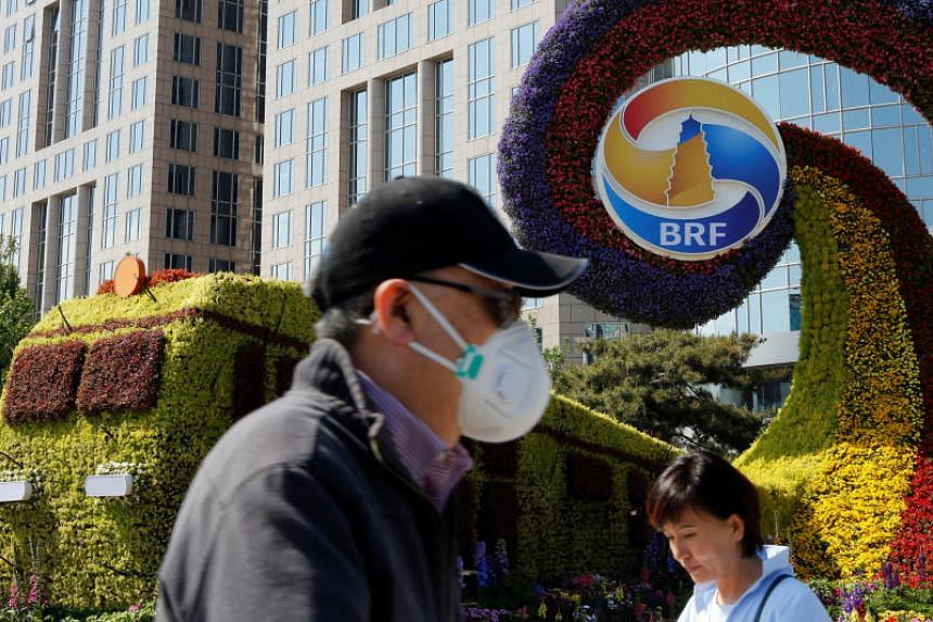 """A flower installation marking the Belt and Road Forum in Beijing. Environment and Water Resources Minister Masagos Zulkifli suggested approaching the endeavour through a """"three-builds"""" concept: build sustainably, build innovatively and build partners"""