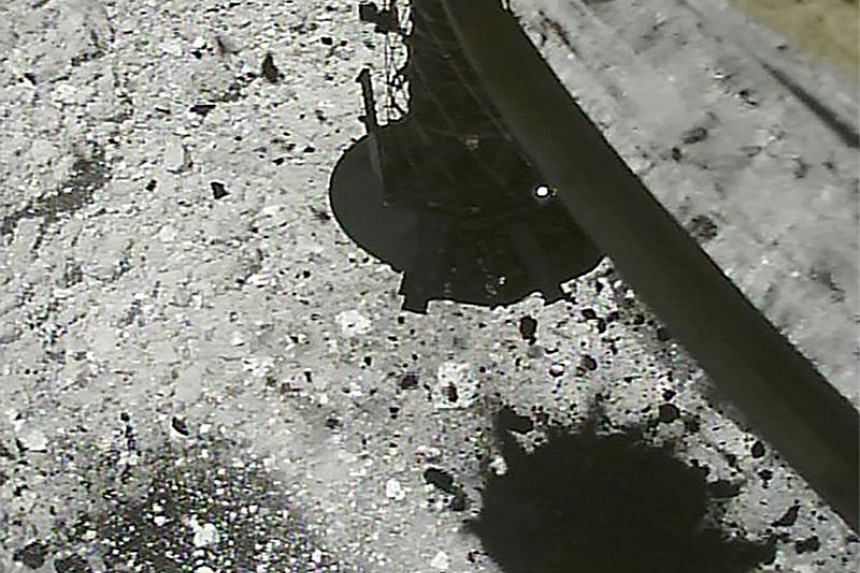 The Hayabusa2 spacecraft after landing on the asteroid Ryugu. Yuichi Tsuda, Hayabusa2 project manager at the Japanese space agency, said it confirmed the artificial crater from images captured by the probe located 1,700m from the asteroid's surface.