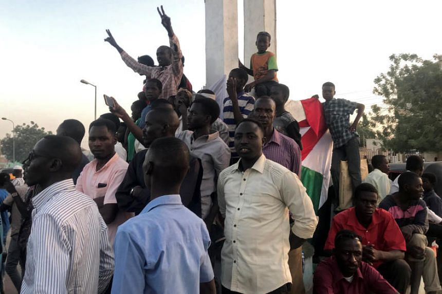 Sudanese demonstrators chant slogans at a mass anti-government protest at the Nyala market in South Darfur, Sudan, on April 24, 2019.