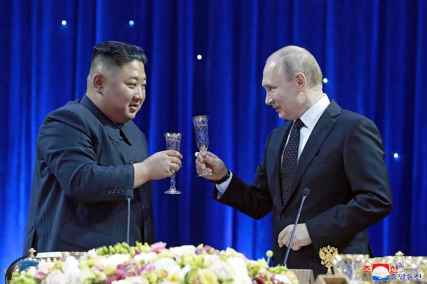 Mr Kim Jong Un and Mr Vladimir Putin raise their glasses for a toast during a grand banquet after Russia-North Korea talks.
