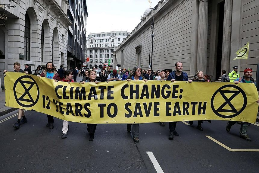 Protesters blocking traffic outside the Bank of England during the Extinction Rebellion protest in London yesterday.