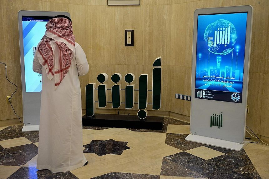 The Absher app, seen here in a display at the Saudi Interior Ministry in Riyadh, gives access to a wide range of government services but also allows men to monitor and control female relatives' travel.
