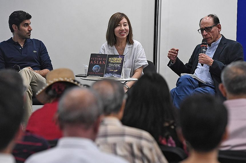 Indian-American global strategy adviser Parag Khanna (far left) and ST associate editor Vikram Khanna (left) discussing their books at Wednesday's Straits Times Book Club, moderated by ST opinion editor Audrey Quek.