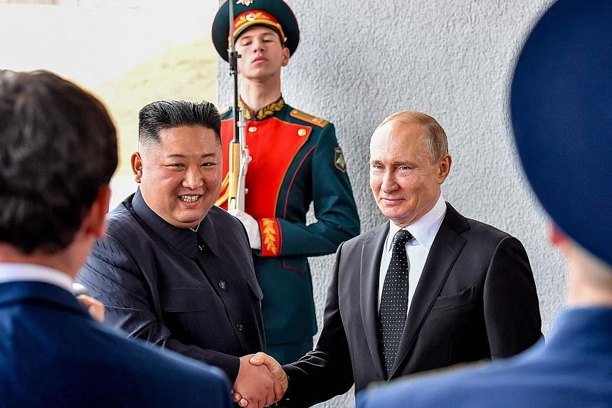Russian President Vladimir Putin welcoming North Korean leader Kim Jong Un before their talks at the Far Eastern Federal University campus on Russky Island in the far-eastern Russian port of Vladivostok yesterday. The summit was the first between lea