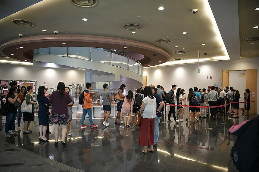 Students queueing to get into the town hall meeting at NUS University Town yesterday. Several times during the session, the university's representatives deferred issues raised to the committee to review NUS' disciplinary and support frameworks, which