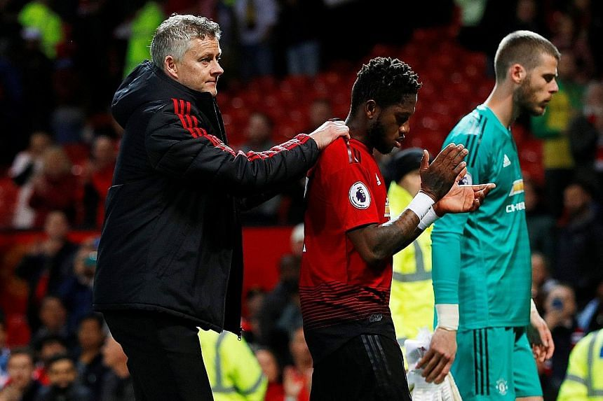 Manchester United manager Ole Gunnar Solskjaer consoling midfielder Fred following the 2-0 Premier League loss to Manchester City on Wednesday, as goalkeeper David de Gea also looks dejected in the background. It was United's seventh defeat in nine m