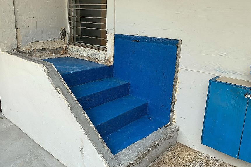 The now bare staircase landing (above) outside a Tampines flat, after a fish tank (left) built on it three to four years ago was removed this week. Citing safety reasons, the HDB said the owner could not keep it.
