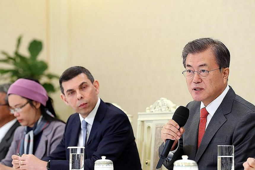 South Korean President Moon Jae-in speaking to visiting editors from Asia News Network, including Straits Times editor Warren Fernandez (centre), at the presidential Blue House in Seoul yesterday. Noting that United States President Donald Trump and
