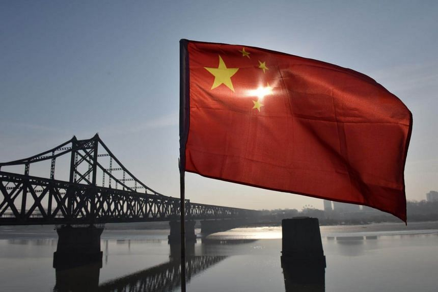 The Chinese flag flies on the Yalu River Broken Bridge in the border city of Dandong, in China's northeast Liaoning province, on Feb 23, 2019.