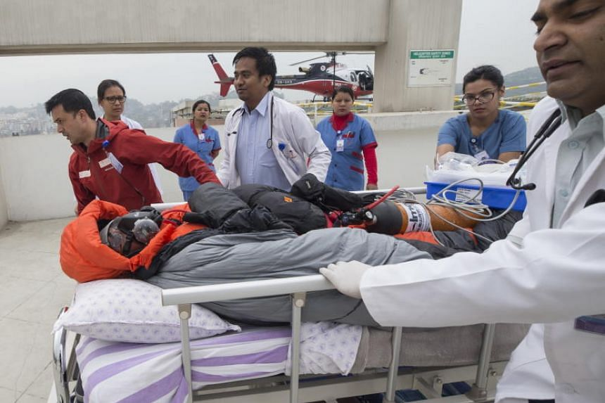 Chin Wui Kin, 48, was airlifted to a hospital in Kathmandu for treatment after rescuers brought him down to a lower camp in a risky operation close to the summit of Mount Annapurna.