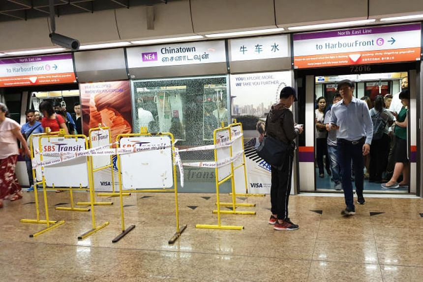 An area at the platform of Chinatown MRT station on the North-East Line was cordoned off after a glass panel shattered on April 25, 2019.