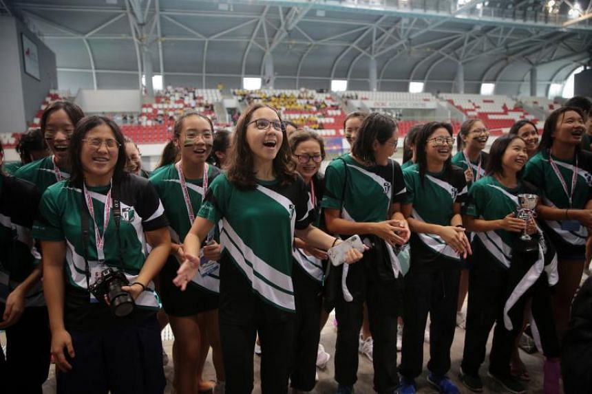 Swimmers from Raffles Girls' School cheer at the conclusion of the Schools National Swimming Championships finals at the OCBC Aquatic Centre on April 26, 2019.