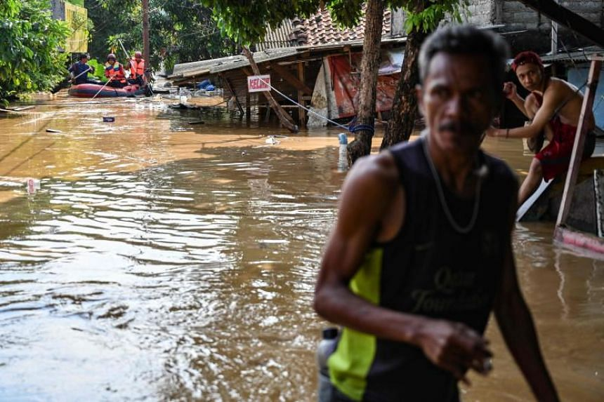 Heavy rain pounded the greater Jakarta area, causing the Ciliwung river to burst its banks, and prompting flash flooding in at least 17 communities.