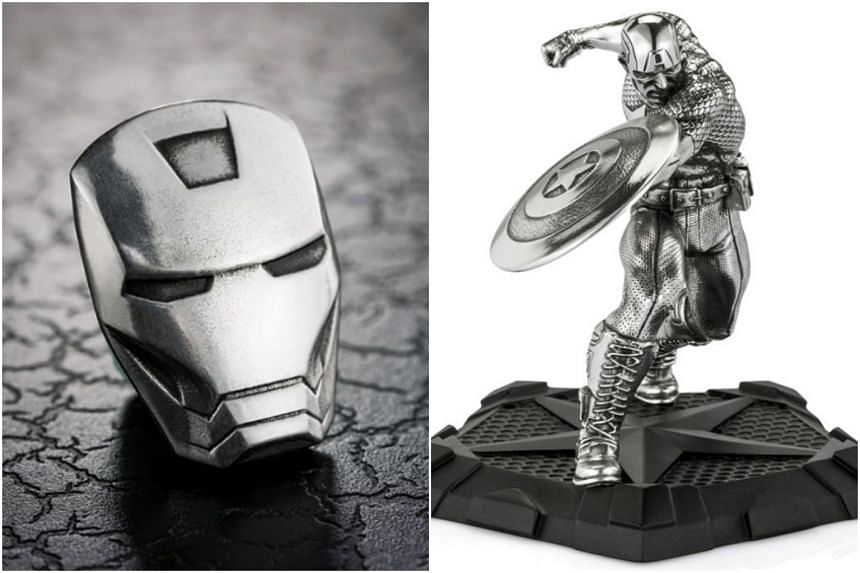 An Iron Man lapel pin (left) and Captain America First Avenger Figurine.
