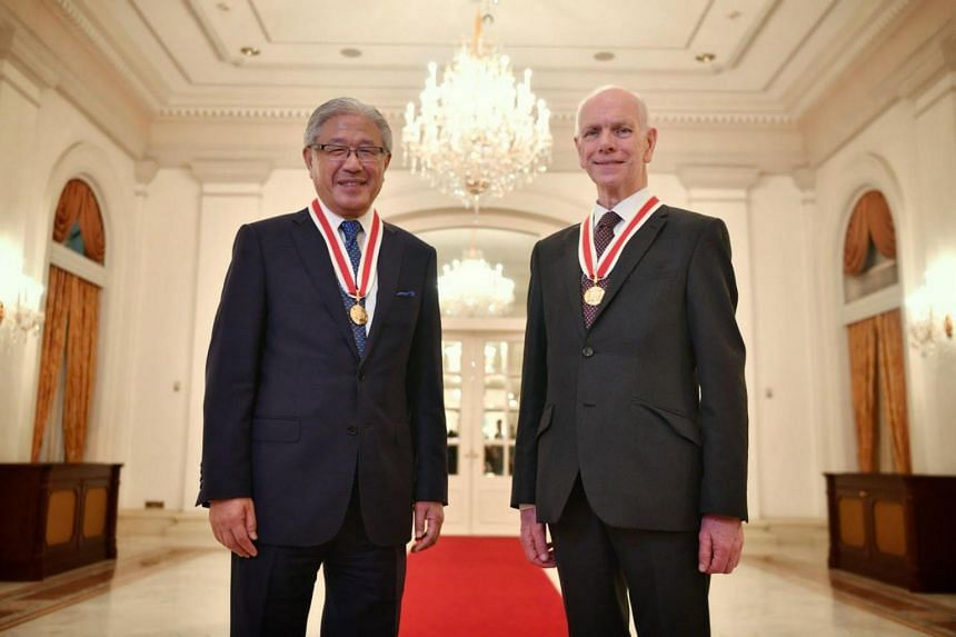 Professor Victor J. Dzau (left), president of the US-based National Academy of Medicine, and Professor Sir John O'Reilly, British engineer at A*Star, received their awards at the Istana on April 26, 2019.