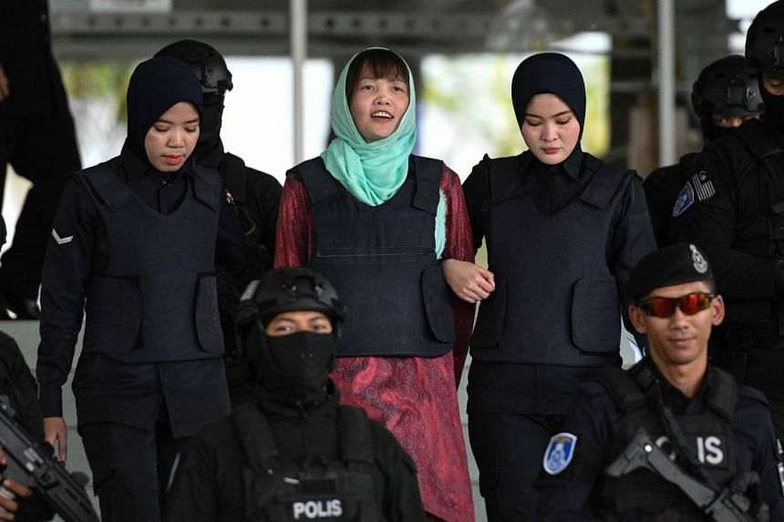 Vietnamese national Doan Thi Huong (centre) escaped the gallows after pleading guilty to an alternative charge.