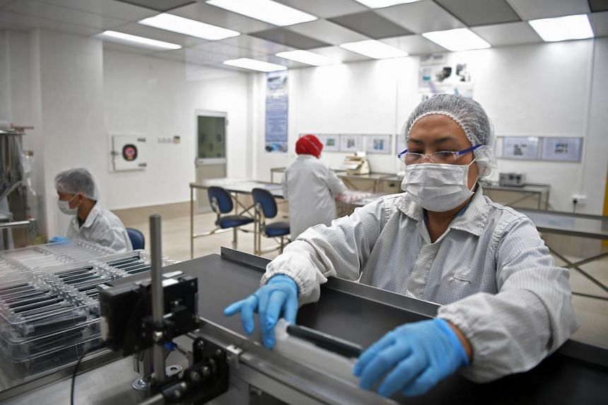 Workers at a facility that designs and manufactures high-value medical devices and lab equipment, on Feb 11, 2019.