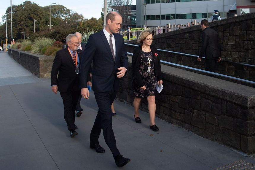 Prince William walks with Dr John Wood, chairman of Canterbury Health Board, and Ms Lynne Johnson, nursing director for Christchurch Hospital, as he arrives at the hospital to meet those still recovering from the mosque attacks, on April 26, 2019.