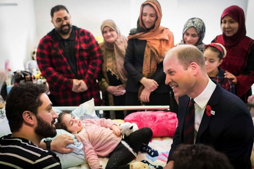 Prince William meeting five-year-old Alen Alsati and her father Wasseim, who are recovering in Starship Children's Hospital in Auckland.