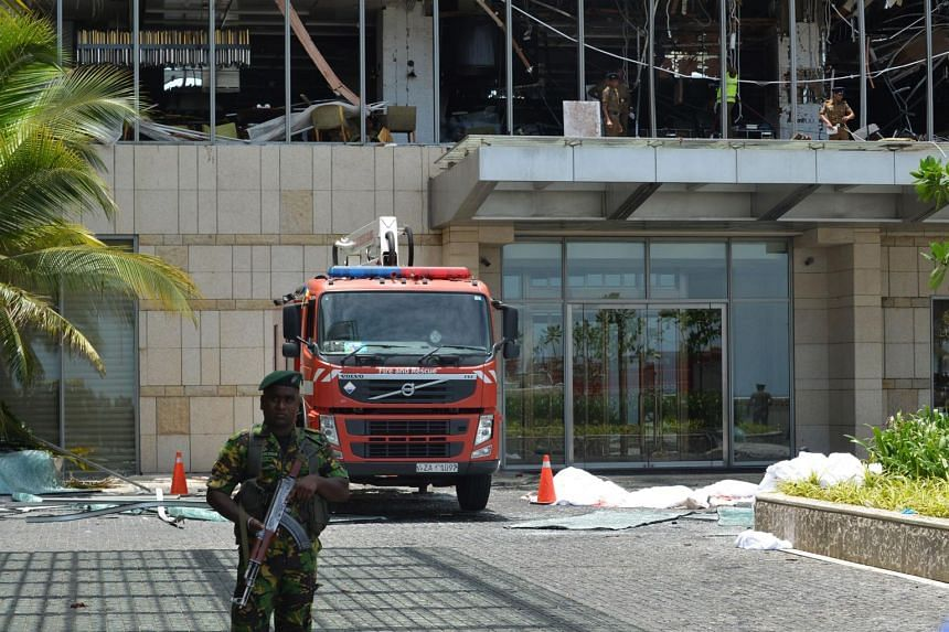 Sri Lankan security personnel stand guard at the entrance of Shangri-La Hotel in Colombo, on April 21, 2019 following an explosion.